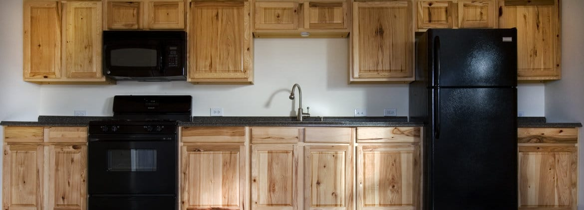 Kitchen cabinets and appliances in apartment