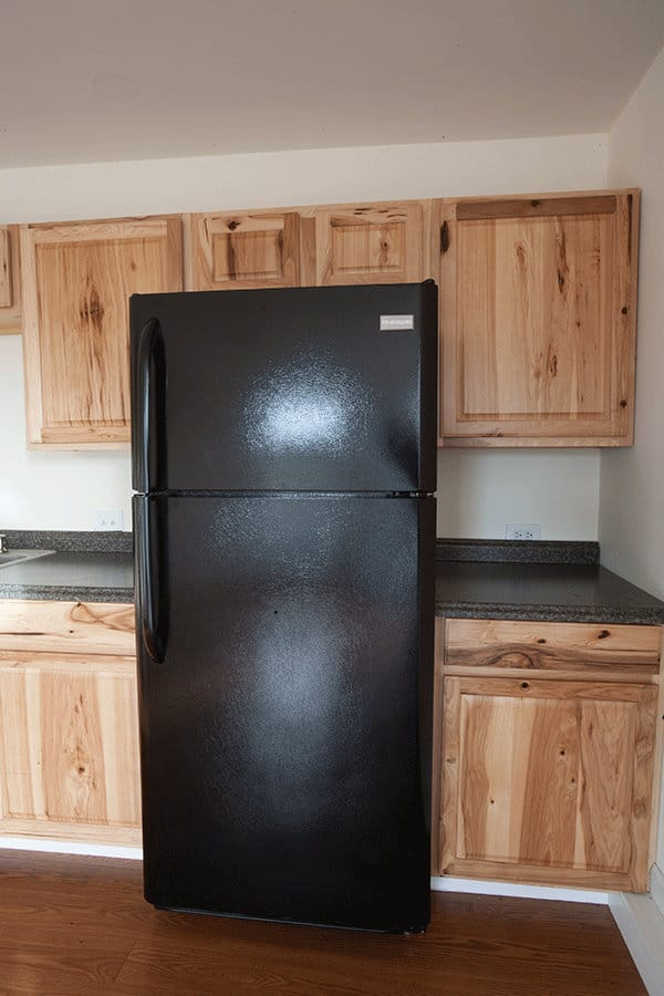 A full size refrigerator in the kitchen
