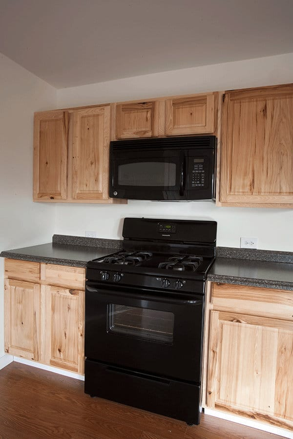 A full size stove and microwave in the kitchen